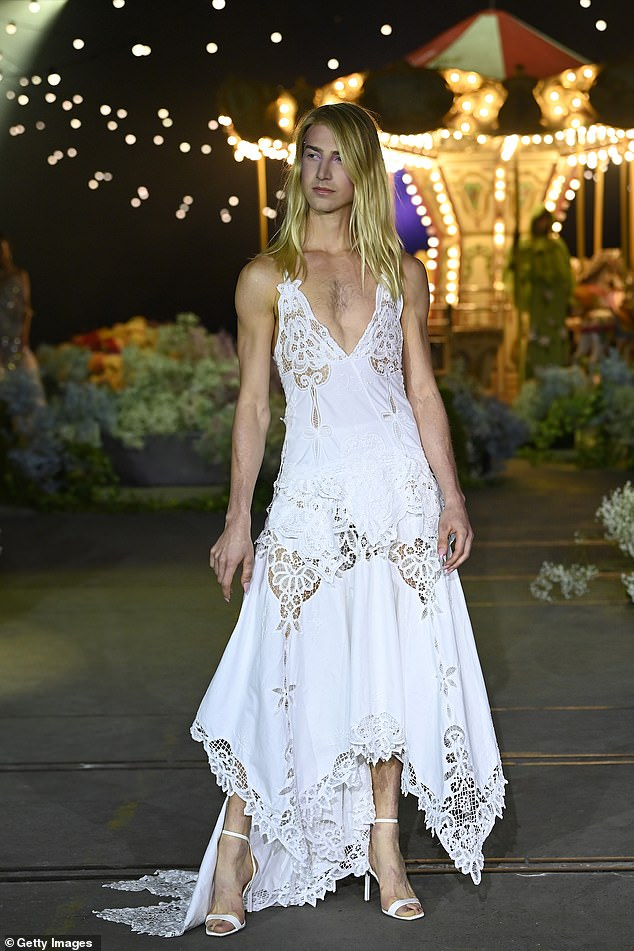 Wow!The 26-year-old stunned as he walked for edgy label Romance Was Born in a white frock
