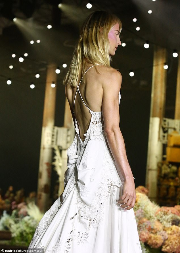 Summery: It also had an open back with crisscrossed straps and a a bunched, bow-like detail