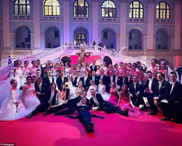Offspring of Russia's elite take a group photo at the Viennese Ball at Gostiny Dvor, the largest hall in Moscow, on Saturday night