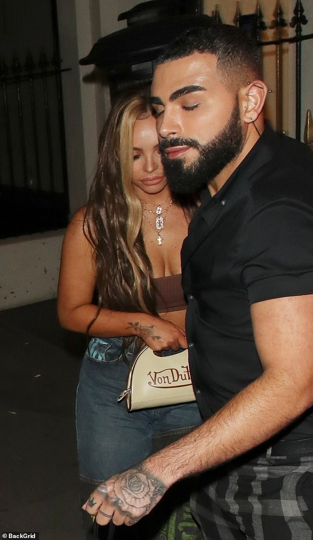 Exit strategy:Despite strict COVID-19 rules still in force in the UK, the ladies night was in full swing as they exited the contemporary Latin American restaurant and bar hidden behind a discreet entrance in the capital