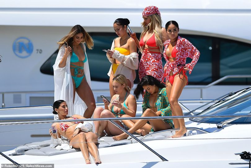 Lounging around: The women showed off the colorful range from Nicole's swimsuit line which she launched in 2017