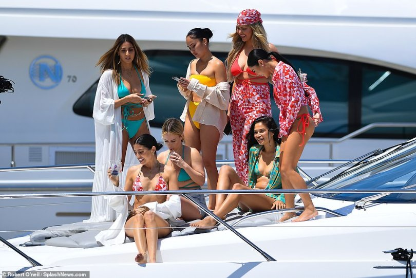 The life: Williams opted for a crisp white cover-up draped down across her forearms as she sipped on cocktails in the sun