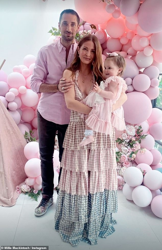 Doting: Millie shares her daughter with her husband and former Made In Chelsea co-star Hugo