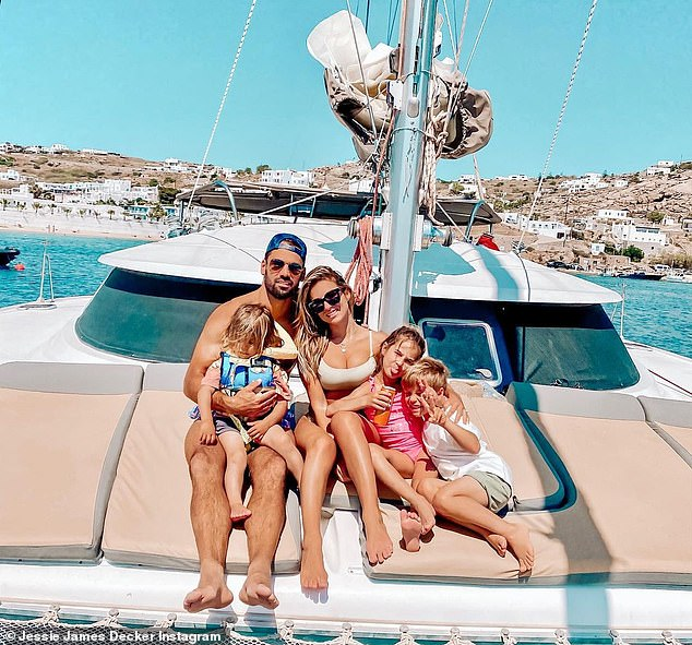 By the sea:Jessie and her husband were joined in another post by their three children: Vivianne, seven, Eric, five, and Forrest, three. They all sat on cushions on the deck of a boat in a bay that appeared to be in the same area
