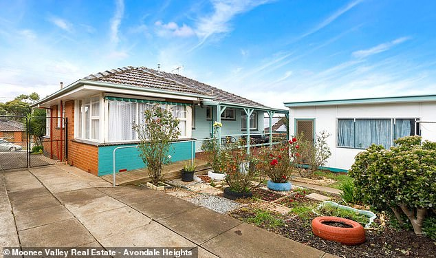 Despite yet another Covid lockdown, Melbourne's median house price last month climbed by another 2.2 per cent to $908,239 but since the start of 2021, they have soared by 9.4 per cent. Pictured is a house at Niddrie with a price guide of $880,000 to $950,000