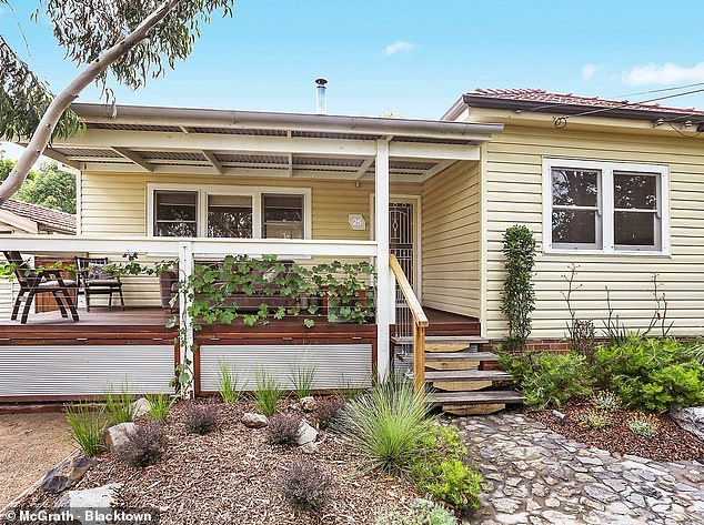House prices in one Australian city have surged by 15 per cent since the New Year with record low interest rates far from the only cause.Sydney's median house price climbed by 3.5 per cent in May to an even more unaffordable $1,186,518, which would pay for something in the western suburbs. Pictured is a house at Seven Hills on the market for $1,050,000