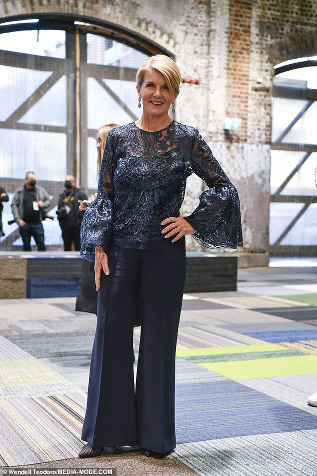 Monday's ensemble: A day before, Juliewowed in a navy blue ensemble - a lace top with bell sleeves above a matching singlet top beneath