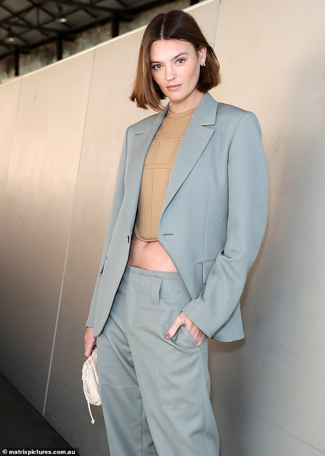 Chic: Model Montana Cox opted for a sophisticated grey power suit with a nude tone crop top that hinted at her trim torso
