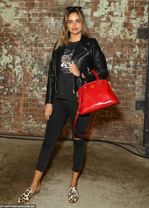Biker chic! Model Samantha Harris rocked a leather motorcycle jacket and a bright red Prada handbag as she attended Australian Fashion Week at Carriageworks on Tuesday