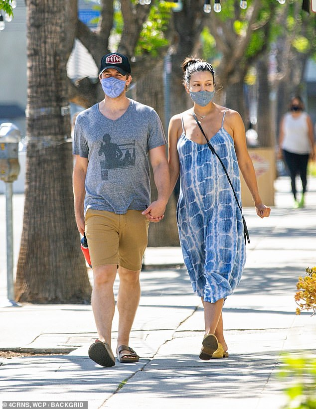 Holiday stroll:Matthew Morrison make the most of his extended holiday weekend by taking a stroll with his pregnant wife Renee on Monday afternoon