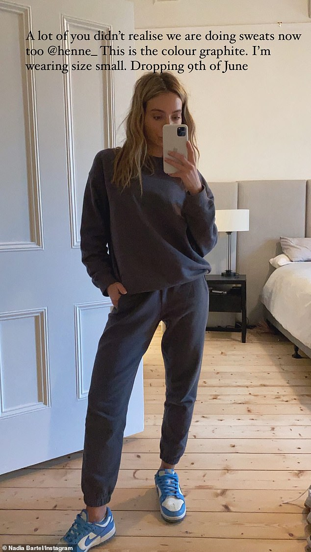 Cosy:Makeup free, the 35-year-old also a mirror selfie to promote her new range of Henne sweats