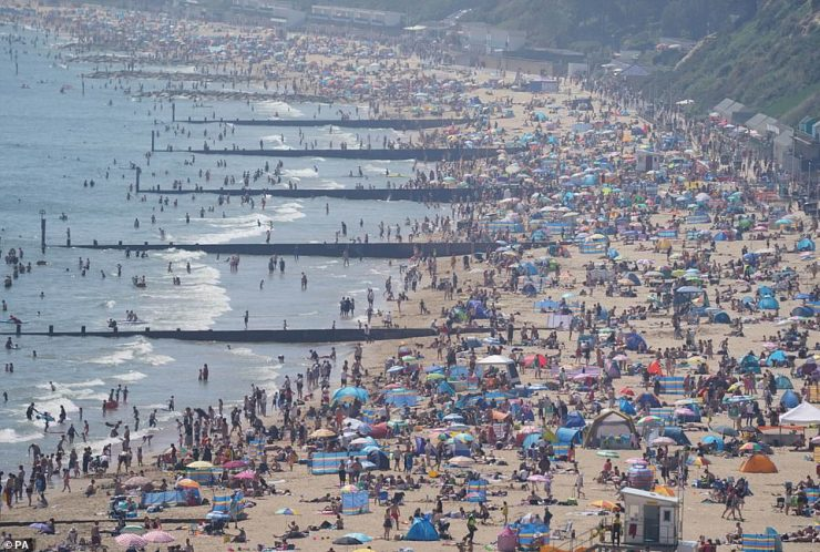 People enjoy the hot weather on Bournemouth beach in Dorset yesterday on what was the hottest day of the year so far