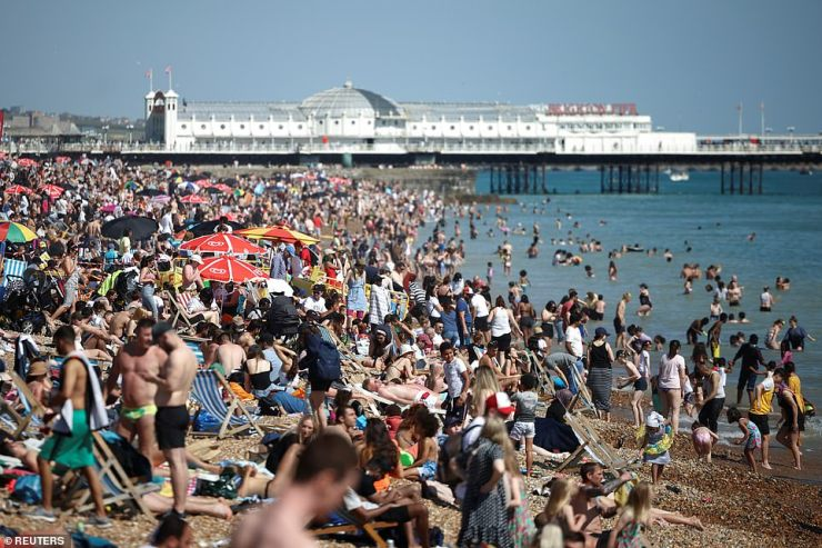 Sunseekers flock to Brighton beach in East Sussex yesterday as they make the most of a very hot bank holiday Monday