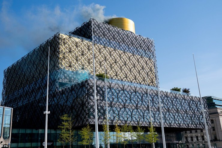 Smoke released from Birmingham Library to represent nitrogen oxides saved by the clean air zone launched today in the city