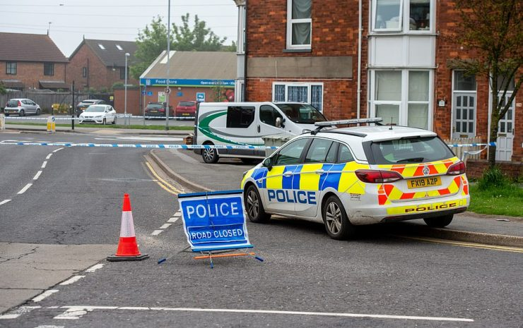 The victims - who have not been named - both suffered multiple stab wounds, Lincolnshire Police confirmed (police pictured at the scene)