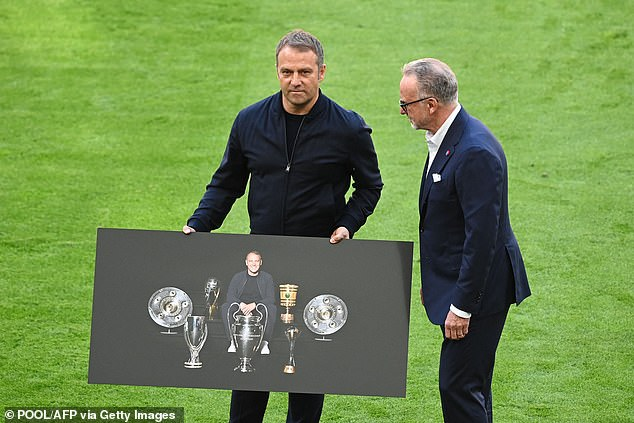 Rummenigge presents outgoing manager Hansi Flick with a poster celebrating his successes