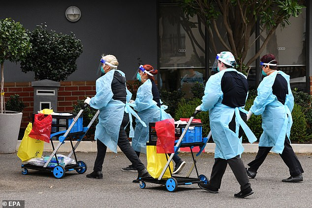 Healthcare workers arrive to the Arcare Aged Care facility in Maidstone, Melbourne, Victoria, on June 1 after a Covid case was reported
