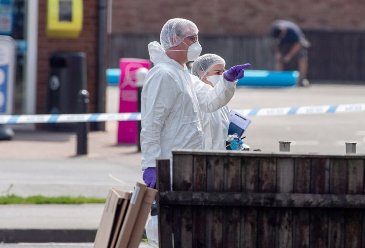 Forensic officers are seen at the scene today.A knife believed to have been used to inflict the injuries was recovered at the scene