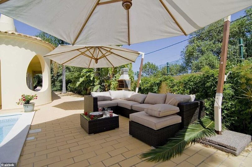 Sunny:There is also a dinner table for al fresco dining amd comfy couches underneath a large umbrella for shade