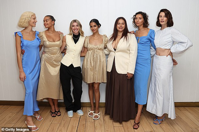 Pals: She posed with a group of other guests, showing off her brown heels