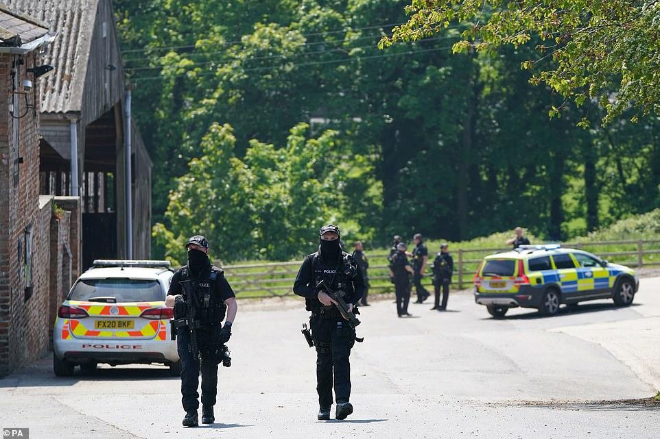 Armed police were seen walking aroundHallington House Farm prior to the arrest of murder suspectBoulton