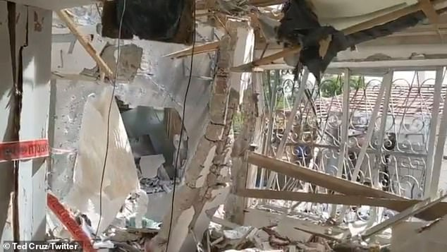 The video showed the crumbling walls of the home, from which the neighbor's unharmed home could be seen outside