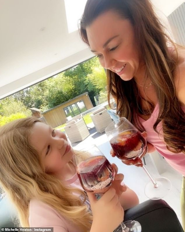 'Who said we need alcohol?' Michelle Heaton posted an Instagram photo on Tuesday with her daughter Faith, 9, raising a toast with 'mocktails' following her own rehab stint