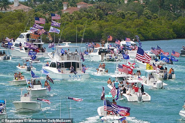 The huge flotilla of boats with a sea of Trump flags takes part of the parade in Jupiter, Florida