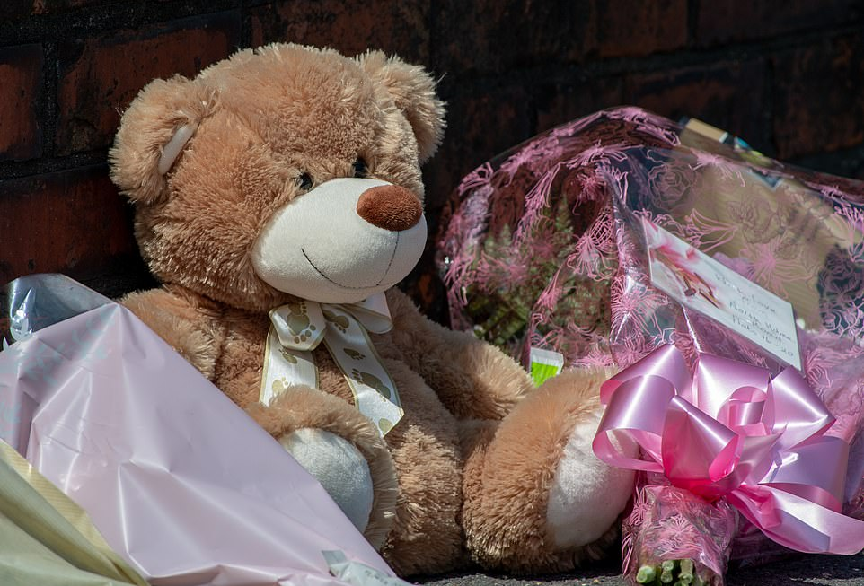 A teddy bear left at the scene of a double murder in High Holme Road, Louth, in Lincolnshire where police remain on scene