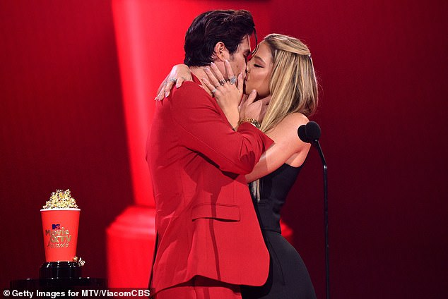 Red hot:They shared a steamy smooch on stage at the MTV Movie & TV Awards at the Hollywood Palladium just weeks ago as they accepted the best kiss award