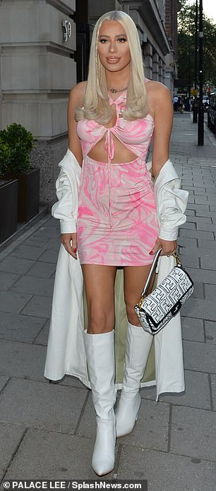 Wow:Demi, 24, looked incredible in a pink patterned cut-out mini dress which she teamed with white knee-high boots and Fendi handbag
