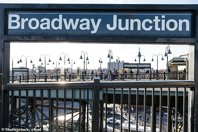 The woman was standing on the platform for the Queens-bound J train around 1:10 p.m. at the Broadway Junction station in Brooklyn