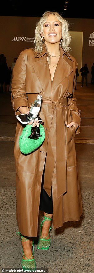 Wow factor:The mother-of-two looked sensational in a show-stopping leather coat in a retro, 1970s-inspired cut and caramel tone