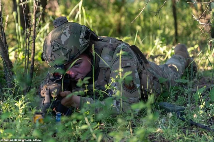 U.S. Air Force Staff Sgt. Jacklyn Edgmond, 435th Security Forces Squadron ground combat readiness training center instructor, secures an initial operating perimeter after joint forcible entry into Cheshnegirovo Airfield, Bulgaria, during exercise Swift Response 21 on May 11