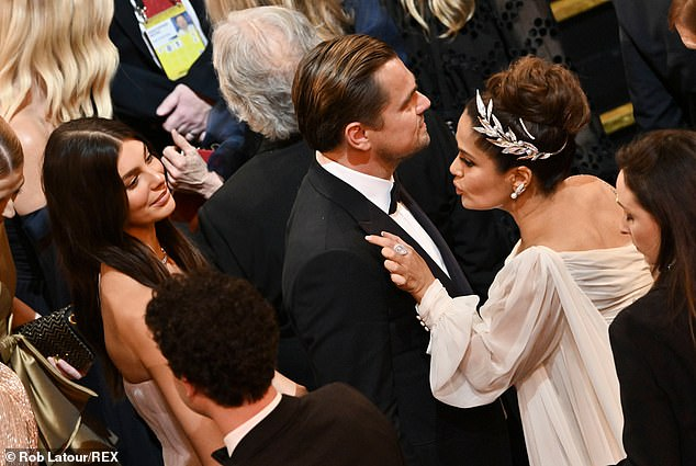 Big step:After dating for over two years, Leonardo and Camila decided to make their red carpet debut during the 2020 Academy Awards ceremony in Los Angeles, California; Camila, Leonardo, and Salma Hayek pictured in 2020