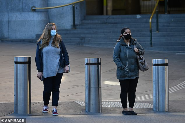 Regional Victorian residents can only travel to Melbourne for a permitted reason and must follow Melbourne restrictions once they get there (pictured, two women in the locked down city on Tuesday)
