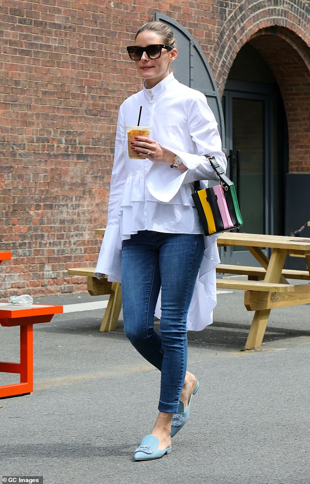 Out and about: Palermo stepped out in pale blue embellished slippers, sported large black-framed sunglasses, carried a multi-color purse and picked up an iced coffee to go