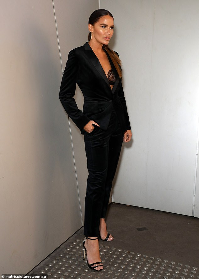 Sheer daring! Jodi Gordon [pictured] flashed a glimpse of her lace bra as she posed in a chic tailored suit at Australia Fashion Week on Wednesday