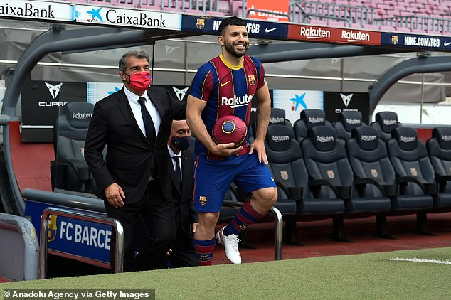 Sergio Aguero hinted he expects Messi to stay at his unveiling at the Camp Nou on Monday