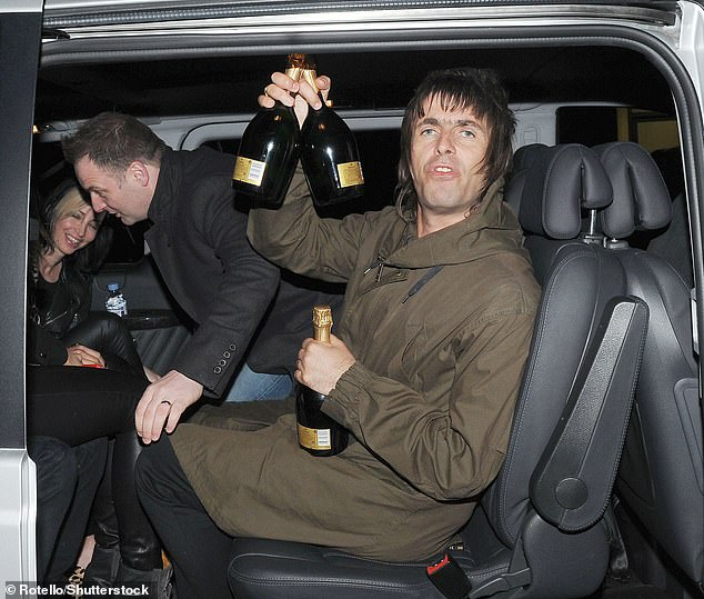 Beverage: The Oasis star, 48, is known for downing beers but he and fiancé Debbie Gwyther have developed a love for the £10-a pop cocktails made of tequila, triple sec and lime juice (pictured in May 2013)
