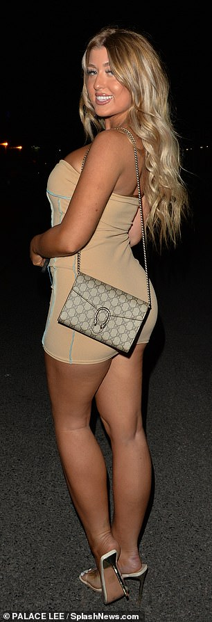 Sensational figure: Twin Jess highlighted her hourglass curves in a figure-hugging beige dress which she paired with nude heels