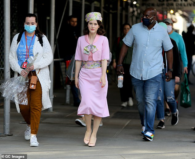Pretty in pink:Rachel Brosnahan turned heads in a ladylike pink ensemble and floral hat on Tuesday in New York City as she transformed into The Marvelous Mrs Maisel for season four