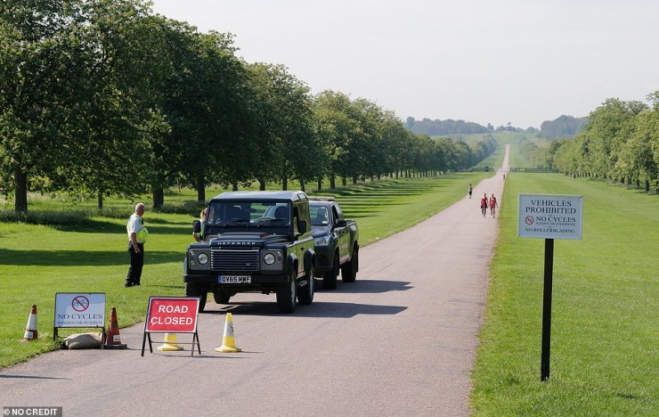 The grounds are empty of the Queen's uninvited neighbours today. Pictured: The Long Walk is nearly deserted