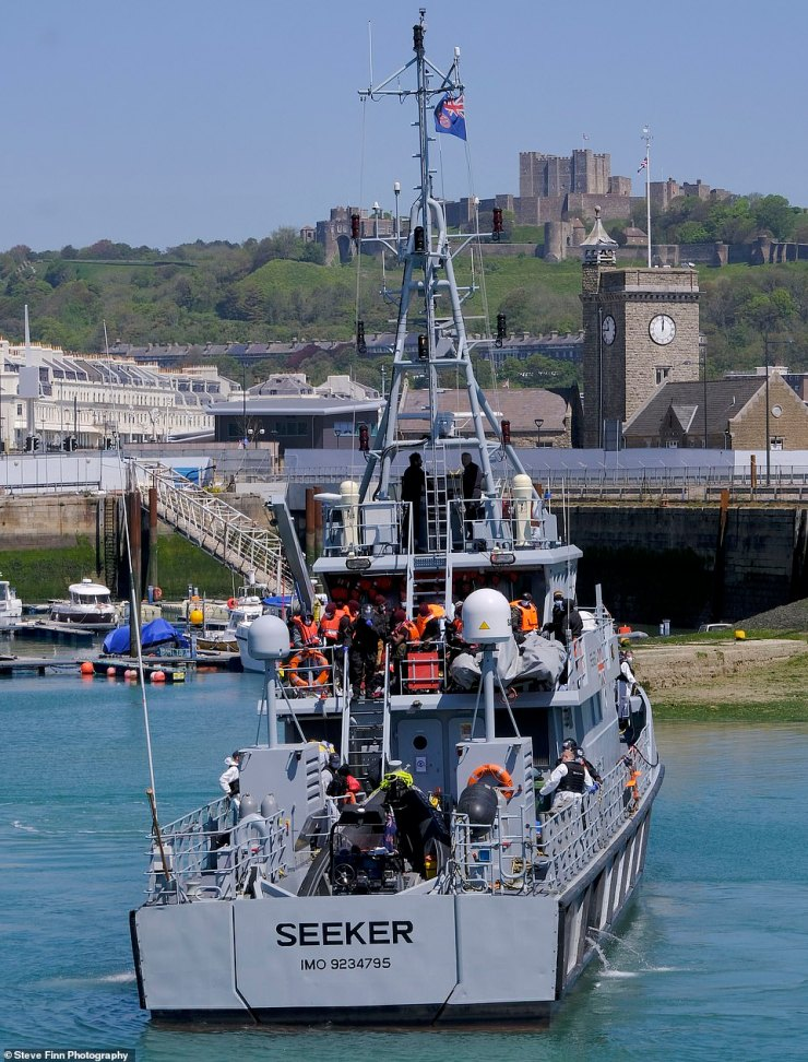 The Border Force cutter arrives at Dover Marina yesterday, with the town's famous castle visible in the background