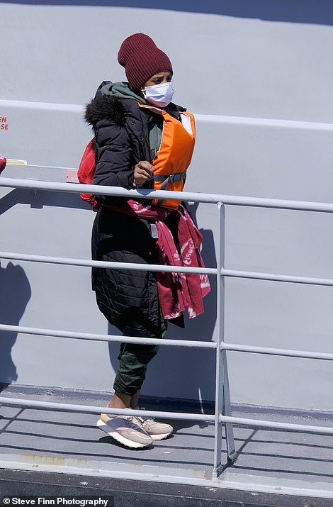 Migrants arrive at Dover yesterday