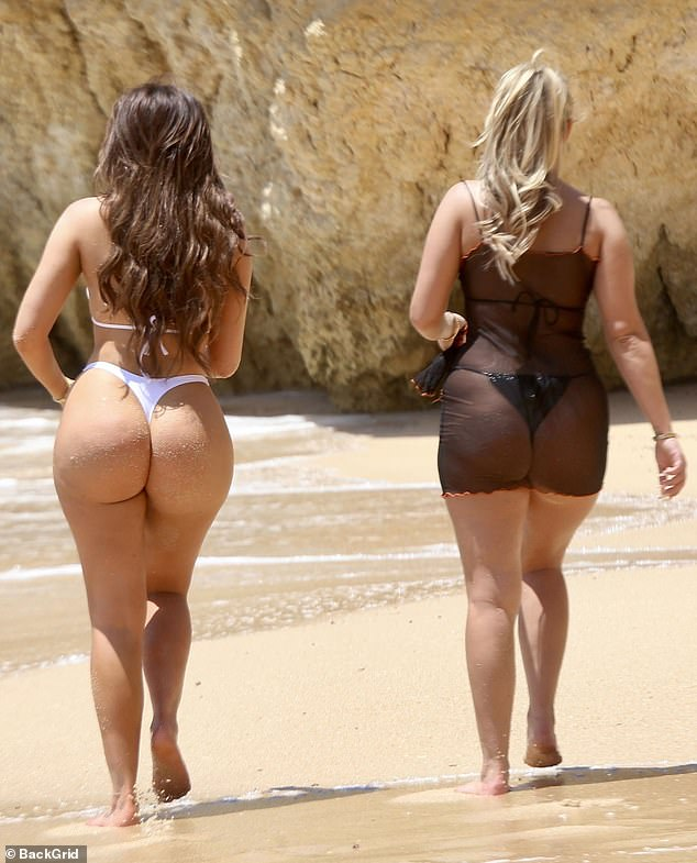 Peachy! The pair opted for thong-bottom bikinis for their time in the sun
