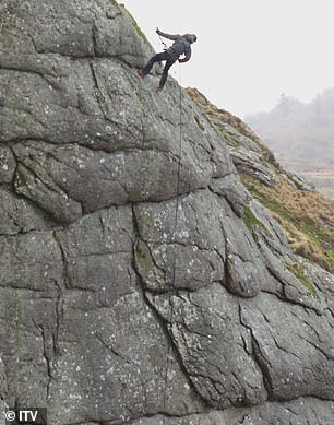 Easy does it: Bear expertly abseiled his way down a cliff