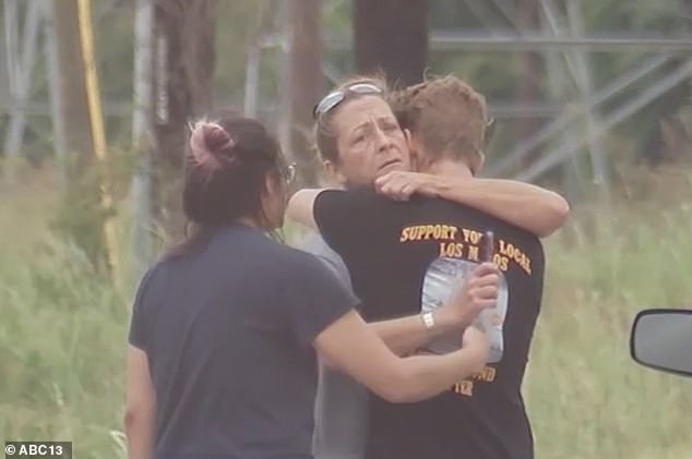 Dalton Olson is pictured embracing his mother, Tonya,, with his girlfriend standing on the side. Tonya Olson said the family are devastated