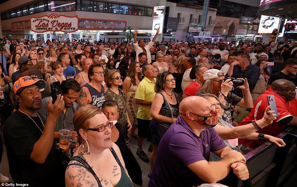 A crowd watches musical act Zowie Bowie in concert during a 'Downtown Rocks Again!' event at the Fremont Street Experience on June 1, 2021 in Las Vegas, Nevada