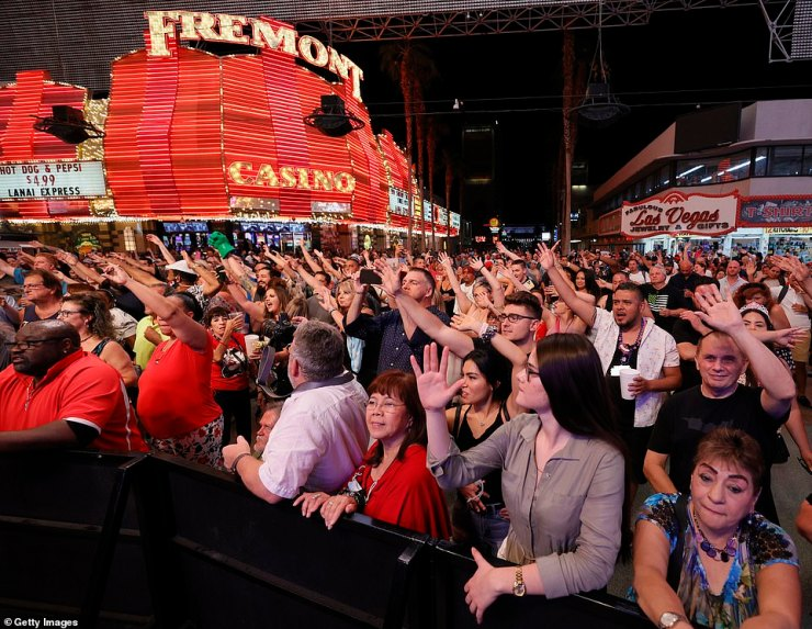 Downtown Las Vegas was hopping June 1 as crowds gathered to watch a local concert after the state dropped most COVID-19 restrictions and said casinos could operate at 100 percent capacity
